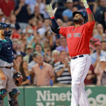 ( Boston, MA, 06/17/16)  Boston Red Sox designated hitter David Ortiz (34) crosses home plate  on his 2 RBI HR in the fourth to tie Ted Williams for Home Runs   as the Red Sox take on the Mariners at Fenway. Friday,  June  17, 2016.  (Staff photo by Stuart Cahill)